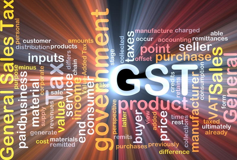 Background text pattern concept wordcloud illustration of GST tax glowing light