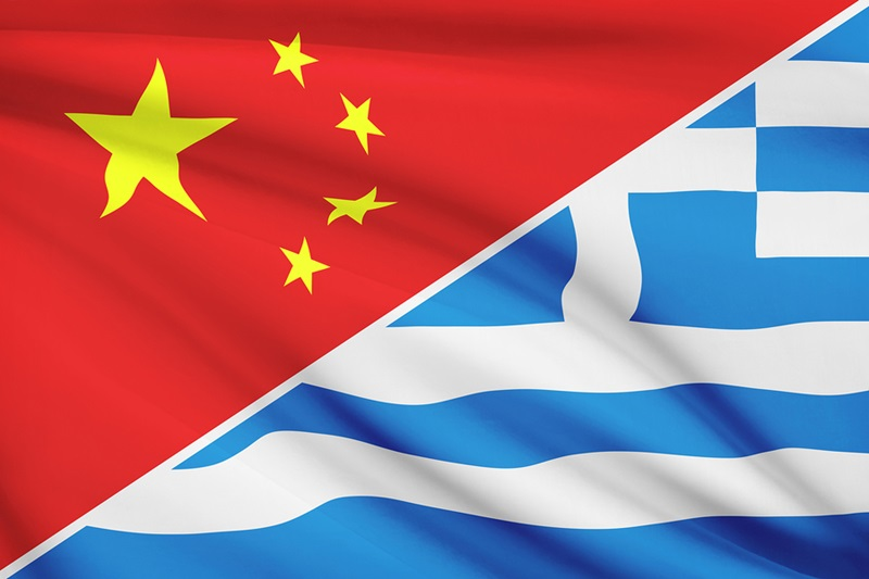Flags of China and Greece blowing in the wind.