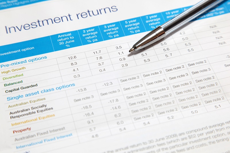 An investment returns statement with ball point pen. Note shallow depth of field focus on ball point pen.