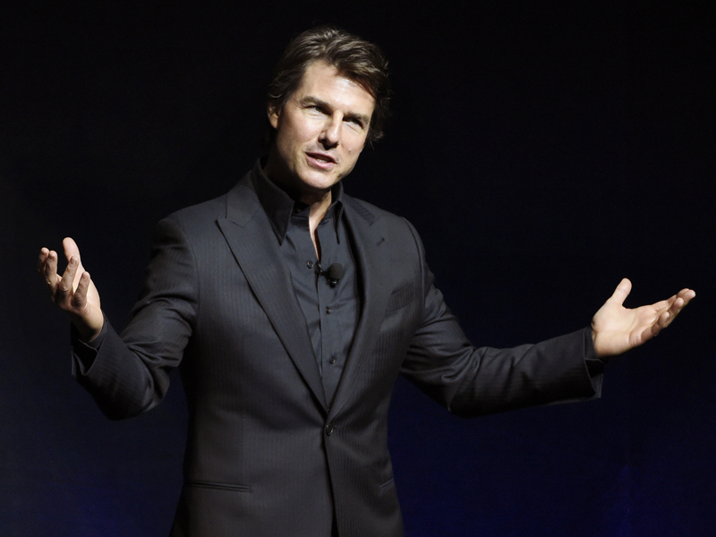 """FILE - In this April 21, 2015 file photo, Tom Cruise, star of the upcoming film """"Mission: Impossible - Rogue Nation,"""" addresses the audience during a surprise appearance at the Paramount Pictures presentation at CinemaCon 2015 at Caesars Palace in Las Vegas. The film arm of e-commerce giant Alibaba Group said Wednesday, June 24, 2015 it will invest in the next """"Mission: Impossible"""" movie in its first Hollywood venture, adding to a flood of Chinese money into the global film business. (Photo by Chris Pizzello/Invision/AP, File)"""