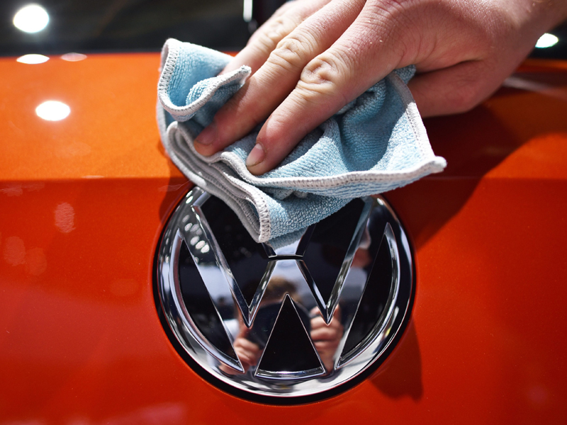 epa04863569 (FILE) A file photo dated 05 May 2015 showing an assistant polishing a VW logo at the Volkswagen AG shareholders'meeting at the fairground inHanover, Germany. Germany's Volkswagen has taken the crown as the world's top carmaker after its sales overtook those of Japanese rival Toyota during the first half of the year, it was reported 28 July 2015. Toyota, the manufacturer of Prius hybrid, Camry sedan and the top-of-the range Lexus, said its group sold 5.02 million vehicles worldwide in the six months ended June, down 1.5 per cent from a year earlier due to weak domestic sales. Volkswagen, which has a long-held goal to overtake Toyota as the world's number, said this month it sold 5.04 million vehicles in the six-month period. VW sales also fell during the first six months of this year, sliding by 0.5 per cent after strong demand in North America and Europe failed to offset a drop in sales in China - the world's biggest car market.  EPA/OLE SPATA