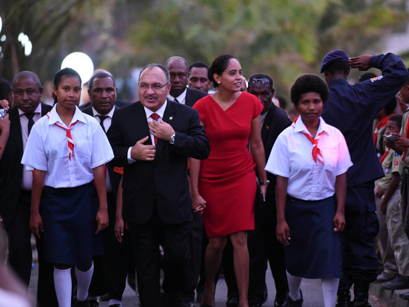 Prime Minister Peter O'Neill (centre) arrives at a ceremony to mark 40 years of independence in Port Moresby, Papua New Guinea, Wednesday, Sept. 16, 2015. It was on this day in 1975 that Papua New Guinea gained independence from Australia. (AAP Image/Mick Tsikas) NO ARCHIVING